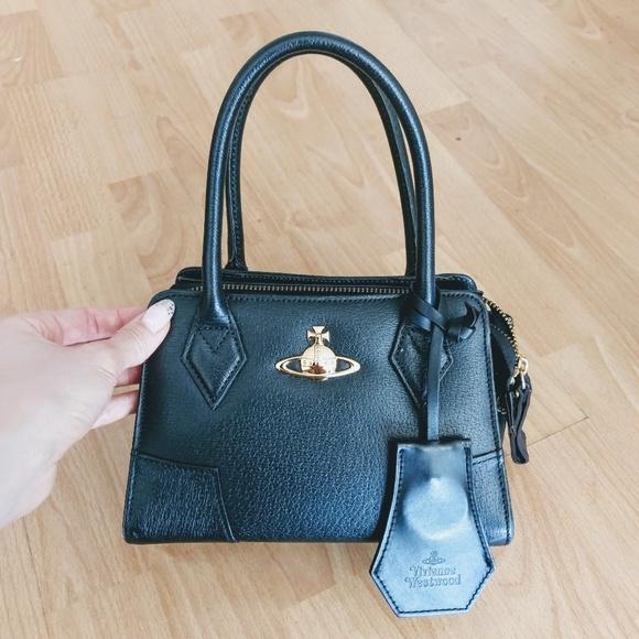 3422a0c9e82 Vivienne Westwood Mini Handbag with Shoulder Strap.  M_5aee044f5521bece95ac59d5